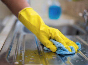 professional office cleaning staff wipes away germs